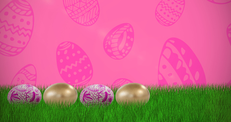 Various Easter eggs arranged side by side against pink background Stock Photo