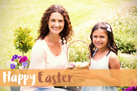 Happy mother and daughter collecting easter eggs against happy easter