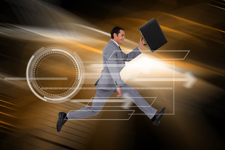 Businessman running with a suitcase against orange light wave over skyscrapers Stock Photo