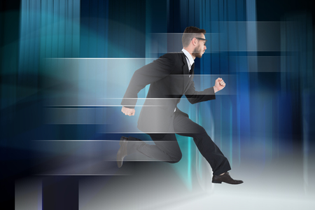 Geeky young businessman running mid air against blue light wave over skyscrapers