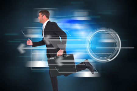 Running businessman against futuristic technology interface Stock Photo