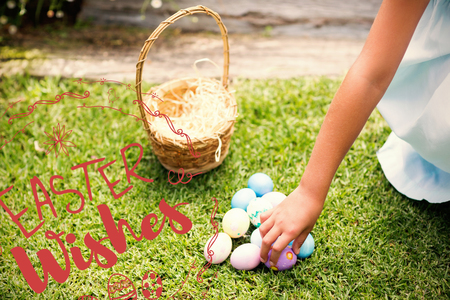 Little girl collecting easter eggs  against happy easter red against a white background Stock Photo