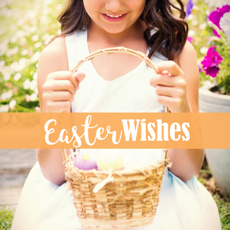 Happy girl collecting easter eggs against easter greeting Stock Photo