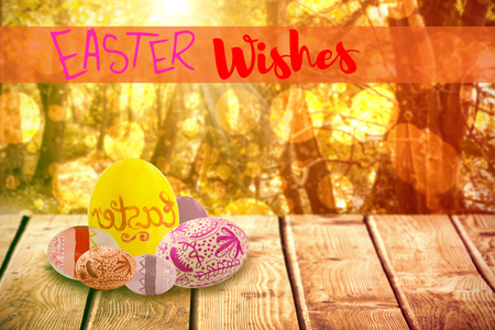 Easter greeting against tranquil autumn scene in forest