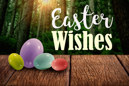 Easter greeting against tall trees in forest