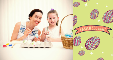 abode: Mother and daughter painting easter eggs