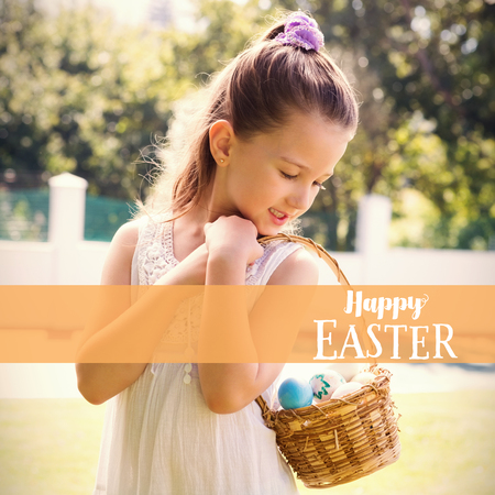 Little girl collecting easter eggs against easter greeting