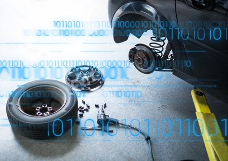 computer repairing: Digital composite of Car with wheel off and blue binary code Stock Photo