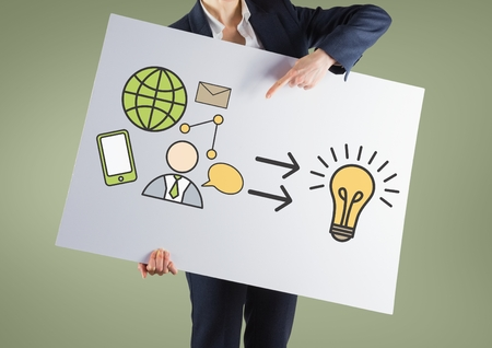 Digital composite of Businesswoman holding card with idea bulb and business graphics drawings