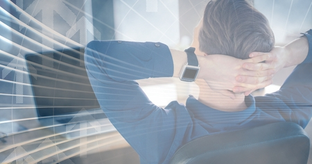 Digital composite of Man at laptop leaning back with arrow graphic overlay Stock Photo