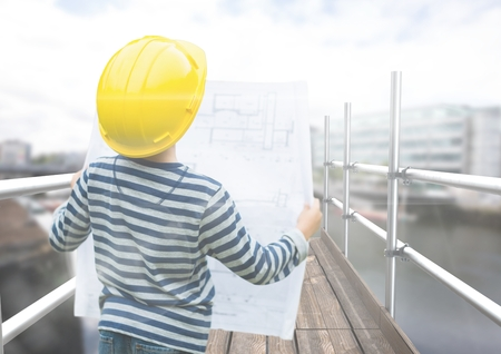 Digital composite of Boy looking blueprint in 3D scaffolding Stock Photo