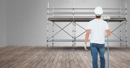 Digital composite of Painter in front of 3D scaffolding