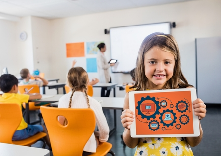 multiracial: Digital composite of Kid in classroom with tablet showing gear graphics against orange background