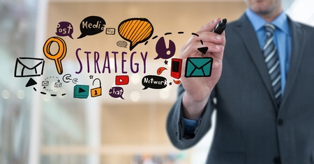 computer club: Digital composite of Businessman writing Strategy text with drawings graphics Stock Photo