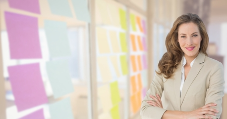 hair do: Digital composite of Happy Business woman with her hands folded  on the office. Blurred back. Stock Photo