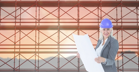 horizon over land: Digital composite of Business woman looking blueprint in front of 3D scaffolding