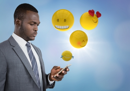 Digital composite of Business man on phone with emojis and flare against blue background