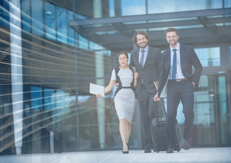 premises: Digital composite of Three business people with luggage and arrow graphic overlay