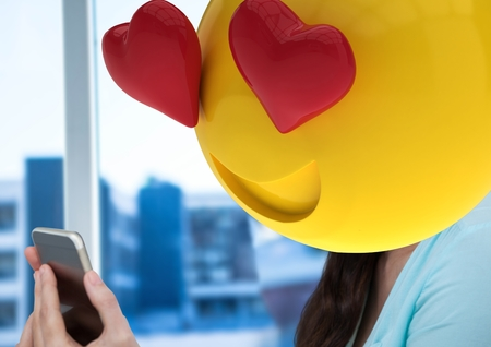 woman cellphone: Digital composite of feeling in love with the message. emoji face. Stock Photo
