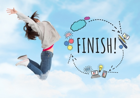 Digital composite of Woman jumping and Finish text with drawings graphics Stock Photo