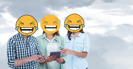 Digital composite of Digital composite of friends with laughing emojis using smart phones and digital tablet