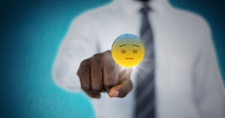 worried executive: Digital composite of Business man mid section touching emojis with flare against blue background Stock Photo