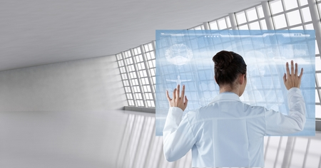 Digital composite of Doctor ( woman) using futuristic tactile screen at the hospital Stock Photo
