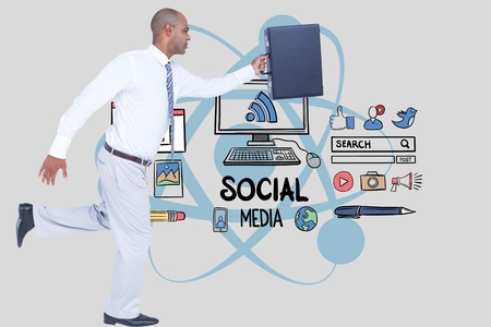 Digital composite of Businessman carrying briefcase while running against social media icons Stock Photo