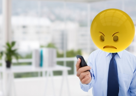 Digital composite of Angry business man  because a  message. Emoji face