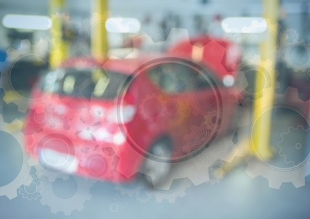 smiley face car: Digital composite of Red car in garage with gear graphic overlay Stock Photo