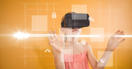 concentrate: Digital composite of Girl looking at various icons through VR glasses Stock Photo