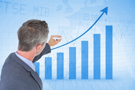 Digital composite of Digital composite image of businessman analyzing bar graph Stock Photo