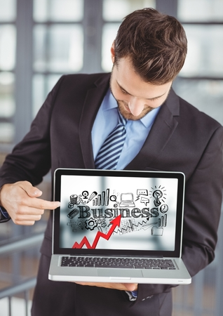 Digital composite of Business man holding laptop showing red arrow with black business doodles against blurry background