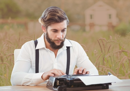classy house: Digital composite of Man on typewriter with soft country background Stock Photo