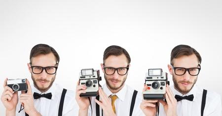 Digital composite of Multiple image of man using retro camera Stock Photo