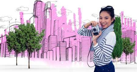 dreariness: Digital composite of Digital composite image of woman holding camera against buildings Stock Photo