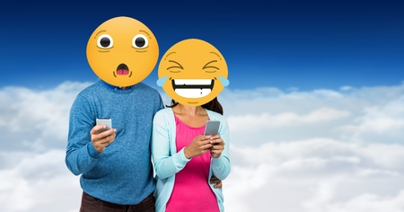 Digital composite of Digitally generated image of friends faces covered with emoji using smart phones against sky