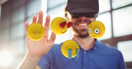 dreariness: Digital composite of Man looking at emojis through VR glasses
