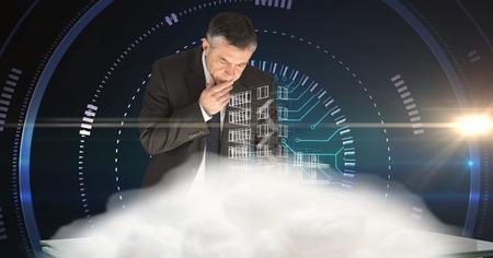 smolder: Digital composite of Businessman working at futuristic desk Stock Photo