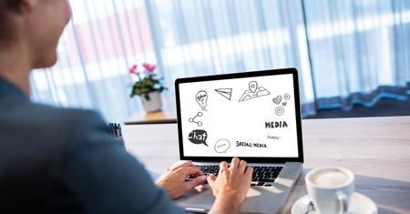Digital composite of Businesswoman analyzing plan on laptop