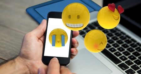 dreariness: Digital composite of Hands using emojis on smart phone