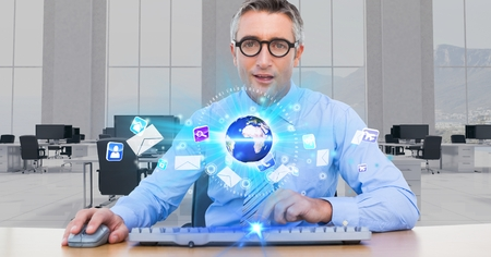 Digital composite of Businessman at futuristic desk Stock Photo