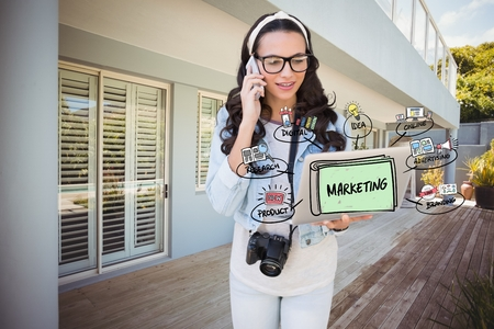 smolder: Digital composite of Digitally generated image of woman using mobile phone and laptop with marketing diagram