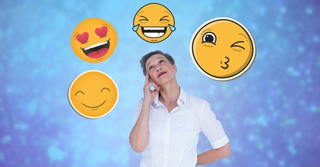 Digital composite of Thoughtful businesswoman with emojis Stock Photo