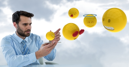 touch sensitive: Digital composite of Digital composite image of businessman with emojis coming out from smart phone Stock Photo