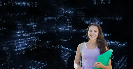 Digital composite of Female student standing over math background