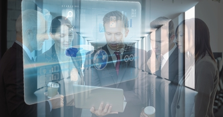 Digital composite of Digital composite image of business people using laptop with icons in office