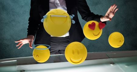midsection: Digital composite of Midsection of businessman with emojis Stock Photo