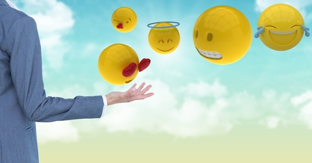 Digital composite of Cropped image of business person standing by various emojis
