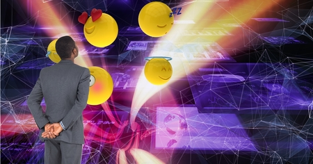 heart monitor: Digital composite of Businessman looking at emojis on futuristic screen